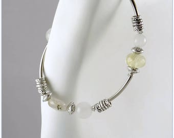 Stone and silvery bracelet with light gemstones, beige rutile quartz and white jade.