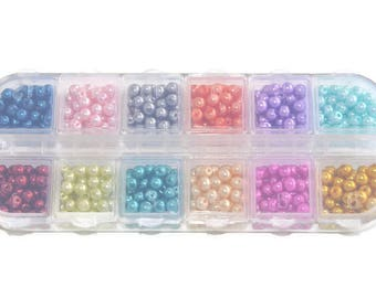 1 box of 600 pearl beads in glass 4mm (50 beads of each color) 12 compartments