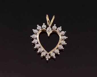10k Diamond Inset Starburst Heart Pendant Gold