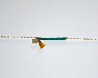 Gold-plated bracelet, micro Turquoise and Hematite beads, gold-plated mini clover paved with Zircons, yellow silk mini tassel