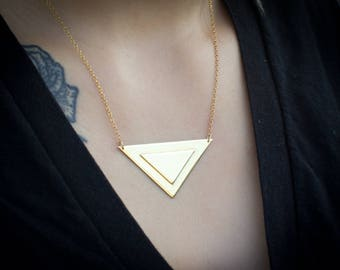 "Brass triangle necklace on gold-filled 16-18"" chain."