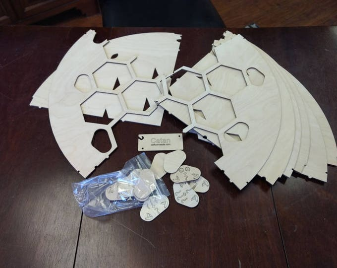Unassembled 4 Player Catan Frame with movable port tiles splits into 4 parts for storage