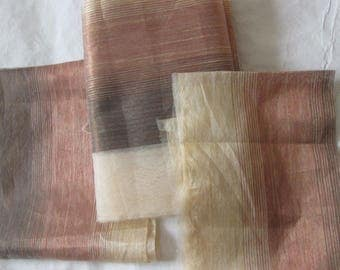 set of three pieces of fabric drapes curtains