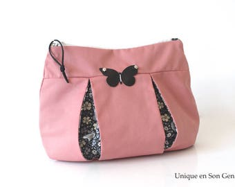 Pink pouch powder creating black Butterfly one of its kind