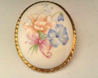 ceramic brooch with flower pattern