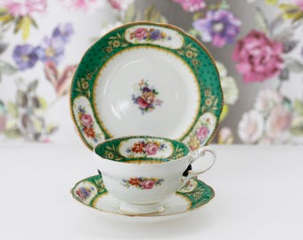 Paragon trio-teaset in Sévres-green pattern with gold gilt rim, colorful floral pattern, marked with old Paragon Star China stamp, numbered.
