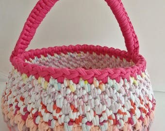 Crocheted in various pastel shades and fuschia trapilho handle basket