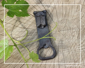Hand made bottle opener with dogs head, forged by blacksmith