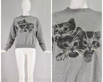 Vintage Womens 1980s Heathered Gray Pullover Crew Neck Long Sleeve Sweatshirt with Kitten Print   Size S/M