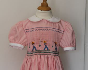Hand embroidered child's smocked dress for T-4 years