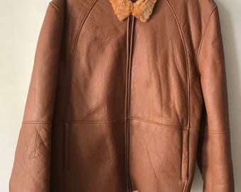 Warm men's coat from real sheepskin and leather winter coat soft fur with collar vintage retro old coat brown color has size-2 extra large.