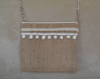Jute bag has glitter and tassel