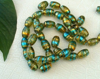 set of 5 OLIVE COSMIC oval 10X14mm threads gold and blue glass beads