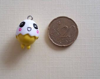 Chick in his shell, yellow and white charm. Kawaii, anime