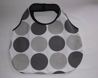 Gray and white round clutch bag