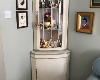 A Mid Century Yew Glazed Corner Cabinet.