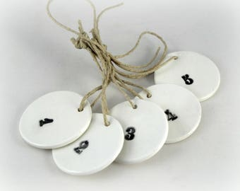 Set of labels make-hand out of ceramics: numbers 1 to 5