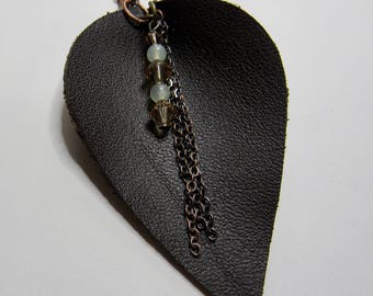 Petal shaped brown leather pendant necklace with beaded charm