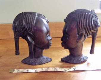 Vintage Tribal Ebony wooden warrior heads, male and female