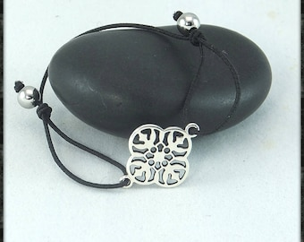 Minimalist bracelet with Silver flower on black elastic cord