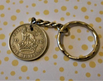 Shilling  1950 (English Reverse) coin attached to a keychain