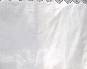 curtain with scalloped embroidery and pleats