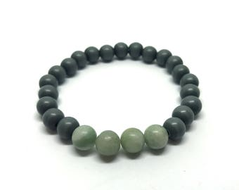 Leather bracelet in combination with beads bracelet with gem