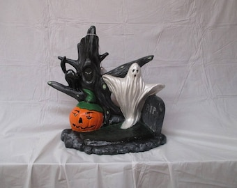 For holloween statue of witch, ghost , pumpkin  tree