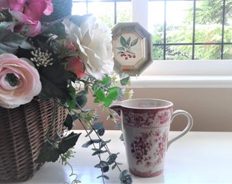 Red and White Transferware Measuring Jug by Powell Craft from the Cuddra Range