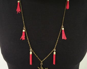 Necklace red tassels and Dove of peace