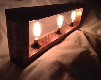 Le Cru a wall/table display lamp