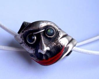 Face in a silver spiral, with Labradoriten as eye
