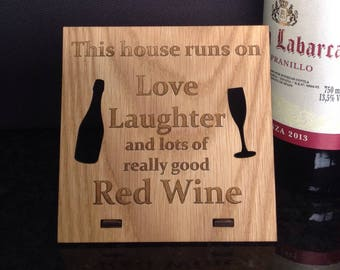 This house runs on love laughter and red wine plaque