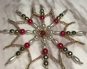Eight-pointed star for the Christmas tree. Ornament in golden-white tones, supplemented with red  beads. Handmade .  New Year's gift.
