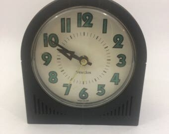 mid century alarm clock black and turquoise plastic antique radio shaped retro