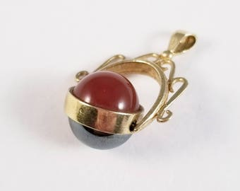 Vintage fob with carnelian and hematite in yellow gold