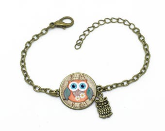 """Bracelet """"Bébé Hibou sur cadran"""", image sous cabochon résine ,monture couleur bronze,ref bA 11"""