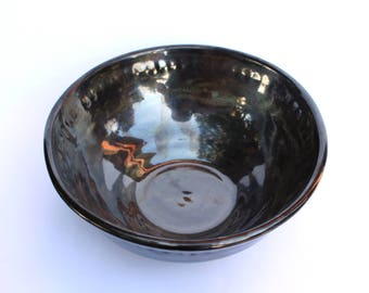 Silver metallic bowl with white frosting and texture design