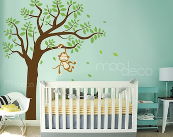 Monkey hanging on tree branch swinging fun wall decal for cute nursery and playroom sticker
