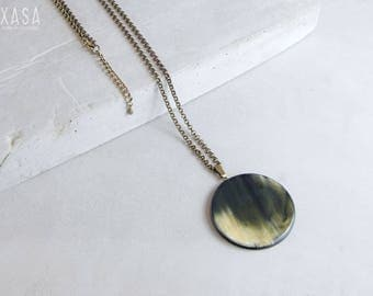 Horn medaillon disc pendant on long chain necklace