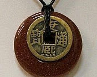 Goldstone Donut with I-Ching Coin