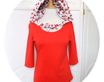 Top has cherries and Red jersey hood, sleeves three quarter red top has hood, sleeves three quarts, red top has cherries, red tshirt