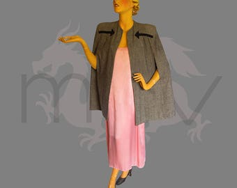 """Femme Fatale 1940s Wool Cape with Arrow Detail: """"Insolent, High Shouldered, Arrow Stabbed, It Makes A Dangerous Woman Of You"""" says the ad"""