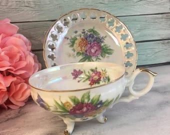 Tri Footed Teacup and Reticulated Saucer White Gold Vibrant Bouquet Lusterware Vintage Japan Stunning Opalescent
