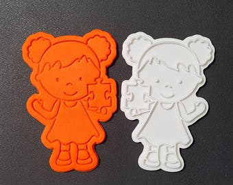 Girl holding a Puzzle Piece  Cookie Cutter and Stamp