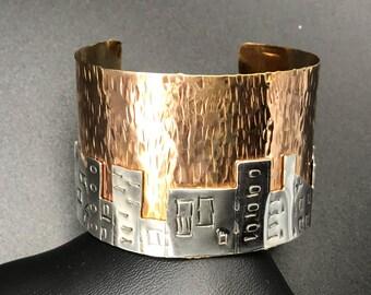 Sterling silver Skyline on Hammered brass