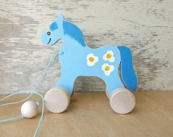 Wood pull along toy Horse in light Blue, hand cut hand-painted toys for kids toddlers, cheerful personalized wood toy animal horse on wheels