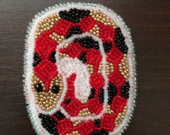 Harlequin snake brooch