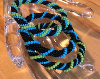 Roll On Glass Bead Bracelets,bangles,set of 3,Handmade by yours Truly,size small, imported beads, made in us.
