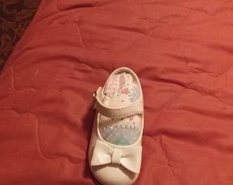 Handmade baby shoe pin cushion